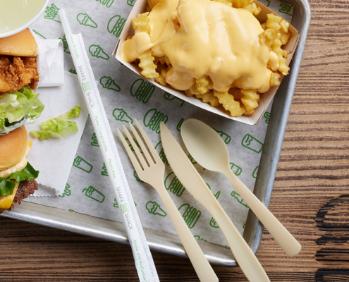 this photo shows biodegradable, sustainable straws and eating utensils being tested at Shake Shack