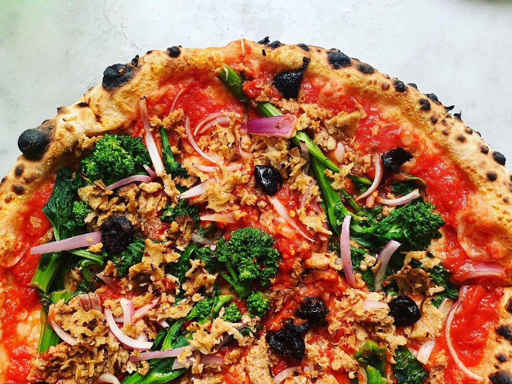 this is a photo of a vegetarian pizza made with seitan-based sausage crumbles available through VEDGEco, a national wholesaler of plant-based foods for the restaurant industry