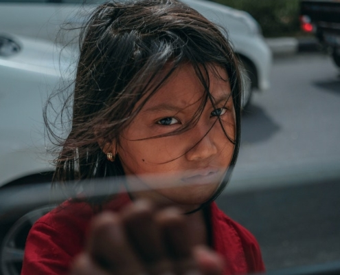 this photo, showing a sad, frightened little girl in a developing nation, illustrates the problem of human trafficking