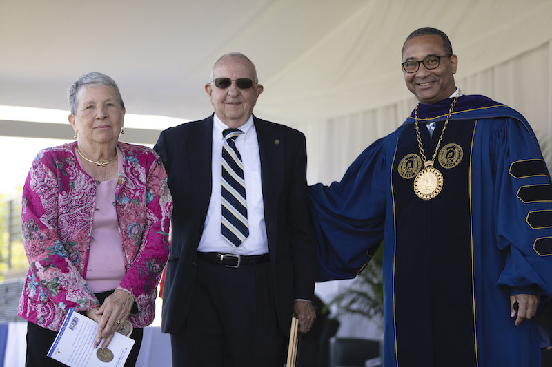 this photo shows Judy and Paul Leonard receiving the Algernon Sydney Sullivan Award at Queens University of Charlotte