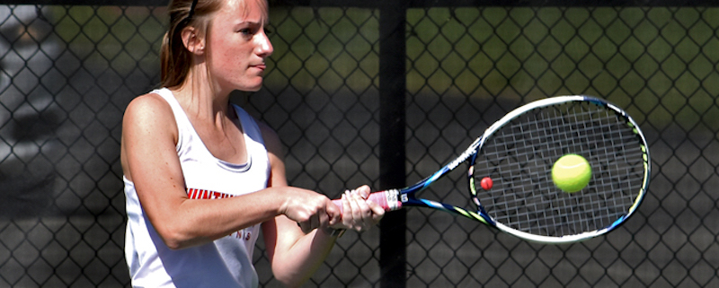 this is a photo of Algernon Sydney Sullivan Award recipient Lucy Burch playing tennis for Huntingdon College