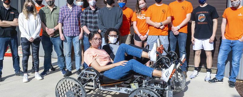 this photo shows Campbell University students in a rover they designed for space missions for a NASA competition.