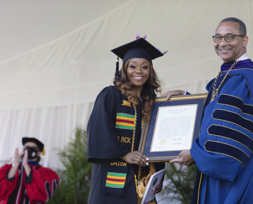this photo shows Sydney Stepney accepting the Algernon Sydney Sullivan Award during a ceremony at Queens University of Charlotte.