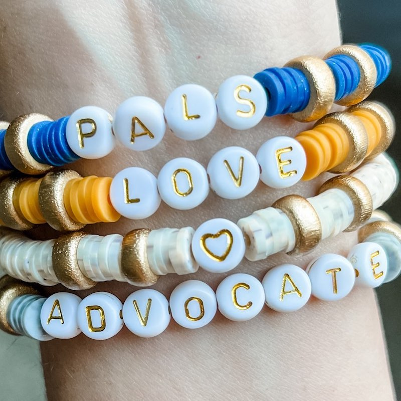 this photo shows a set of bracelets offered by The Upside Down Collection, a business started by Lucy Graham, who has Down syndrome