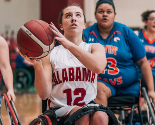 this photo shows Abby Bauleke, a women's wheelchair basketball athlete whose team won the bronze medal at the Tokyo Paralympics