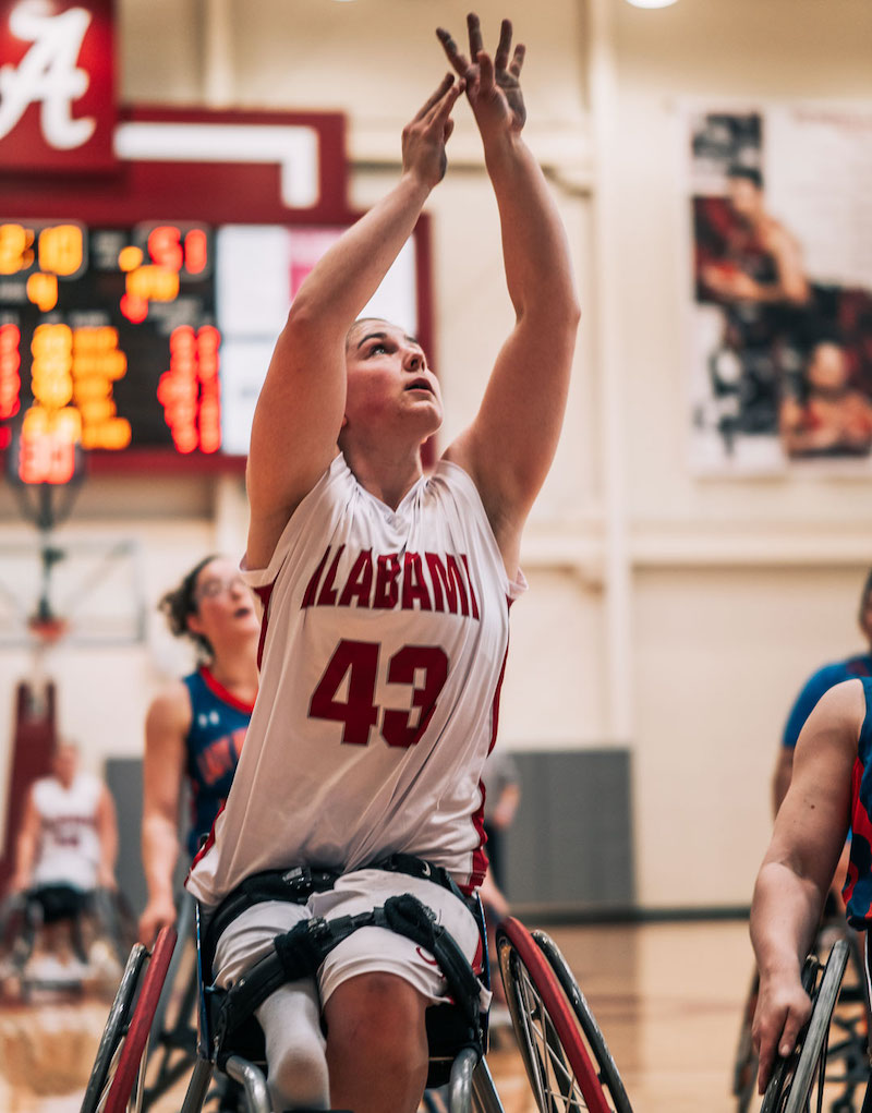 this photo shows women's wheelchair basketball athlete Bailey Moody of the University of Alabama